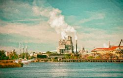 Industrial Paper Mill on a Harbor stock photography