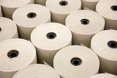 Industrial Paper Rolls. Industrial White Paper Rolls in a Row royalty free stock image