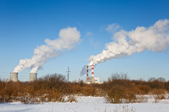 Industrial park with chimney and white smoke on Stock Photo