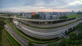 Industrial park and housing blocks along expressway. Long exposure of the transportation infrastructure. Royalty Free Stock Photography