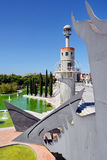 Industrial park of Spain. Parc de l'Espanya Industrial in Barcelona, with giant metal dragon by the sculptor Andrés Nagel, fountains and light houses royalty free stock images