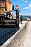 Industrial pavement truck or machine laying fresh bitumen Stock Images