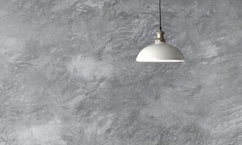 Industrial pendant lamps against rough wall. Industrial pendant lamps against rough wall with gray cement plaster. Edison light bulbs in loft style Stock Photography