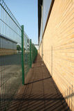 Industrial Perspective. Receding parrallel lines between industrial unit and fencing Royalty Free Stock Images