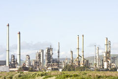 Industrial petroleum refinery at dusk Royalty Free Stock Image