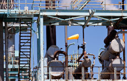 Industrial Petroleum Refinery Plant Smokestacks and Piping Royalty Free Stock Images