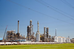 Industrial Petroleum Refinery Plant Smokestacks and Piping Royalty Free Stock Photos