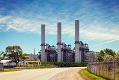 Industrial Petroleum Refinery Plant Smokestacks and Piping Stock Photo