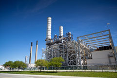 Industrial Petroleum Refinery Plant Smokestacks and Piping Stock Photography