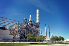 Industrial Petroleum Refinery Plant Smokestacks and Piping Royalty Free Stock Photo