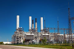 Industrial Petroleum Refinery Plant Smokestacks and Piping Royalty Free Stock Image