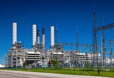 Industrial Petroleum Refinery Plant Smokestacks and Piping Royalty Free Stock Photography