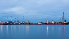 Industrial petroleum refinery river front Stock Images