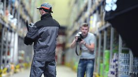Industrial Photo Session. Photographer Making Business Photo Session Inside the Warehouse. Industrial Footage stock video