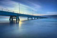Industrial pier on the sea. Side view. Long exposure photography Royalty Free Stock Photos
