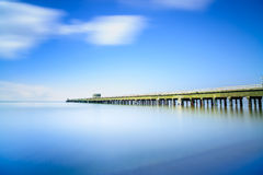 Industrial pier on the sea. Side view. Long exposure photography. Stock Photos