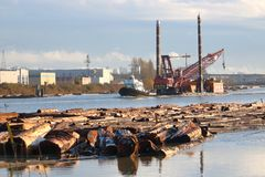 Industrial Pile Driver on River Barge Stock Images