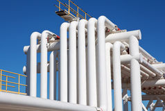 Industrial pipe with gas and oil and water. On a background of blue sky Stock Photo