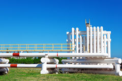 Industrial pipe with gas and oil and water. On a background of blue sky Stock Image