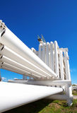 Industrial pipe with gas and oil and water. On a background of blue sky Royalty Free Stock Photo