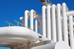 Industrial pipe with gas and oil and water. On a background of blue sky stock images