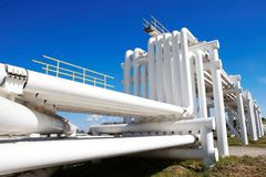 Industrial pipe with gas and oil and water. On a background of blue sky stock photos