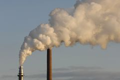 Industrial pipe pollutes air Stock Images