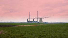 Industrial pipe polluting atmosphere Stock Photography