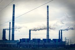 Industrial pipe polluting atmosphere. Color image Stock Photos