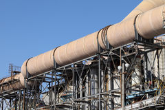 Industrial pipelines. Against blue sky royalty free stock photography