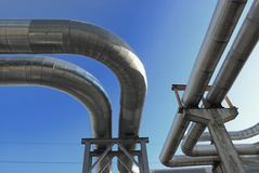 Industrial pipelines. On pipe-bridge against blue sky Royalty Free Stock Photos