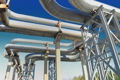 Industrial pipelines. On pipe-bridge against blue sky royalty free stock image