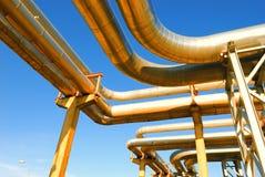 Industrial pipelines. On pipe-bridge against blue sky stock image