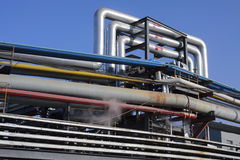 Industrial pipelines against blue Stock Photos