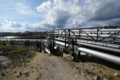 Industrial pipelines  against blue sky Stock Images