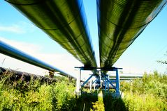 Industrial pipelines against blue sky Stock Photos