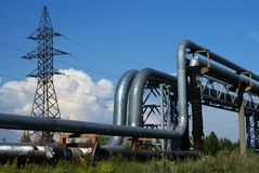 Industrial pipelines against blue sky Stock Photo