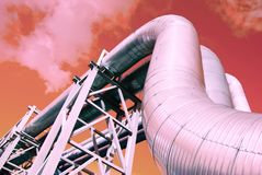 Industrial pipelines against blue sky. Metallic pipeline over blue sky Royalty Free Stock Images