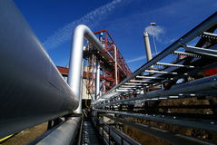Industrial pipelines against blue sky Stock Photography