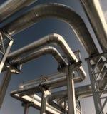 Industrial pipelines against blue sky. Industrial pipelines on pipe-bridge against blue sky stock image