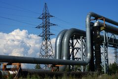 Industrial pipelines and electric power lines stock photos