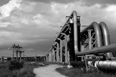 Industrial Pipelines On Pipe-bridge Against Sky Bw Royalty Free Stock Image