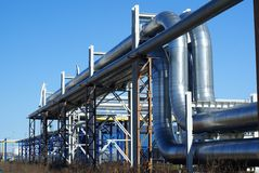 Industrial pipelines on pipe-bridge Royalty Free Stock Images