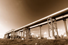 Industrial pipelines on pipe-bridge Stock Photo