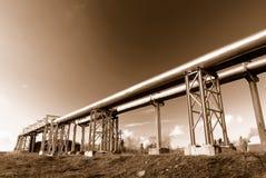 Industrial pipelines on pipe-bridge. Against blue sky stock photo