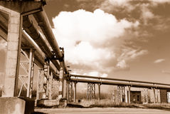 Industrial pipelines on pipe-bridge. Against blue sky Royalty Free Stock Photos