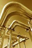 Industrial pipelines on pipe-bridge. Against blue sky royalty free stock image