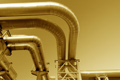 Industrial pipelines on pipe-bridge. Against blue sky Royalty Free Stock Photography