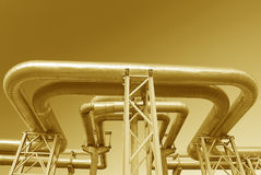 Industrial pipelines on pipe-bridge. Against blue sky Royalty Free Stock Photo