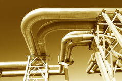 Industrial pipelines on pipe-bridge. Against blue sky Royalty Free Stock Images
